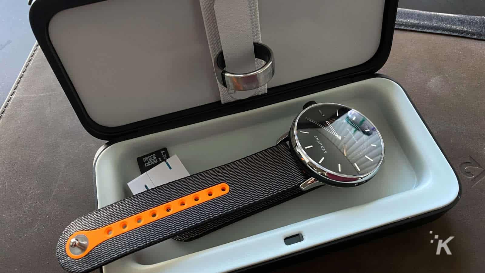 trova go smart lockbox with ring, watch and storage devices inside