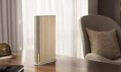 bang and olufsen beosound emerge speaker on a desk
