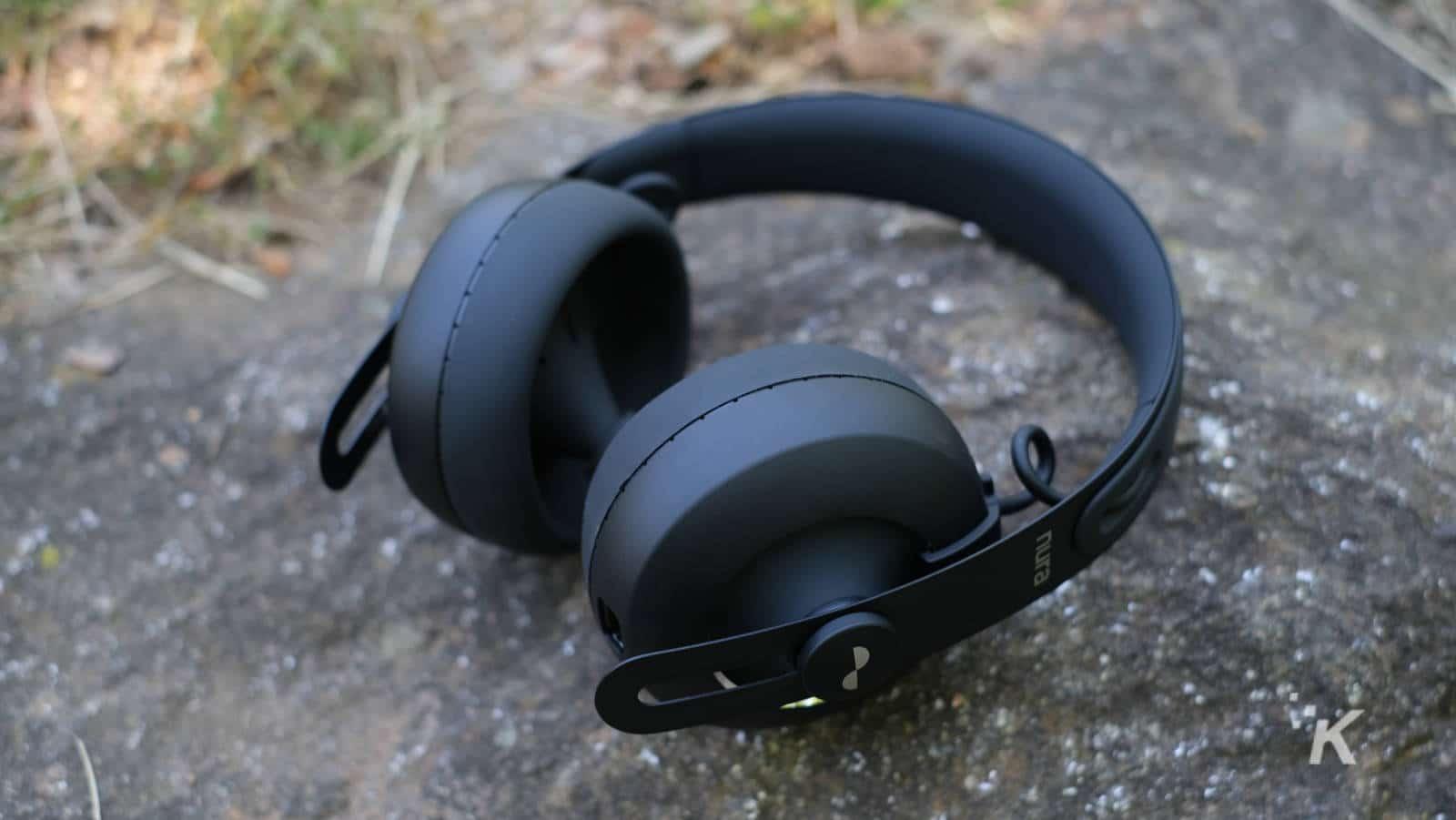 nuraphone headphones on a rock