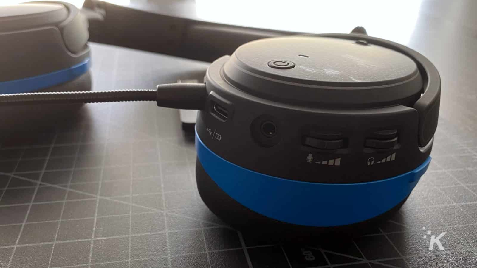 audeze penrose gaming headphones showing controls on earcup