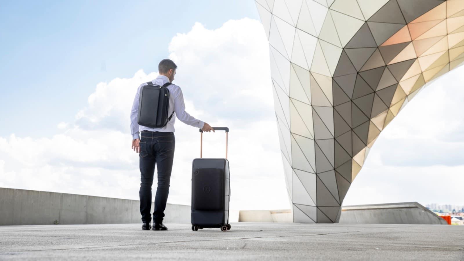 kabuto smart suitcase next to a man