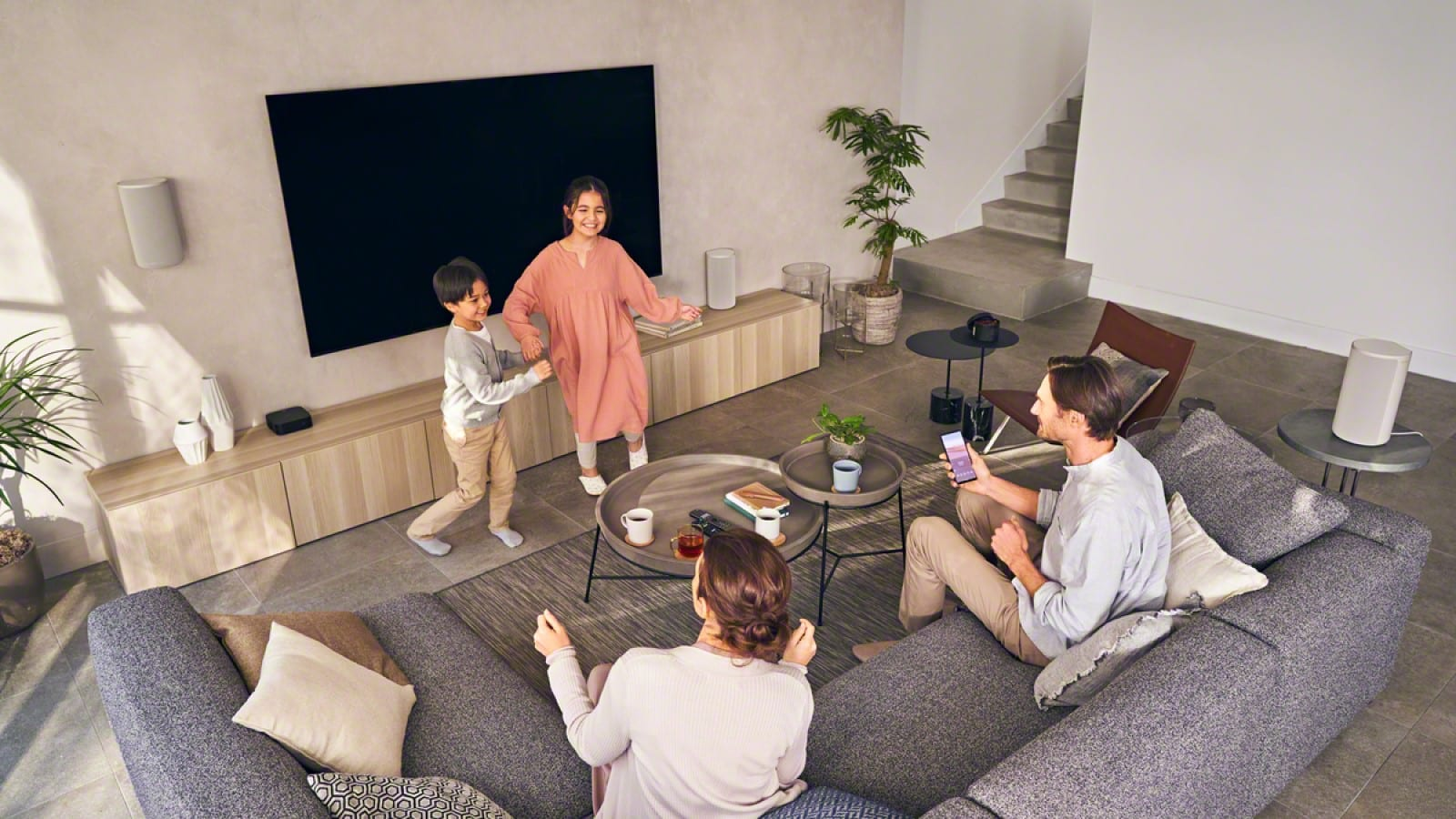 sony ht-a9 wireless speaker setup in a living room with a family listening to music