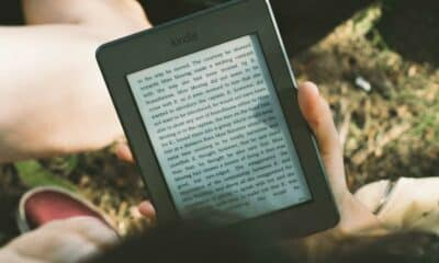kindle tablet in hand