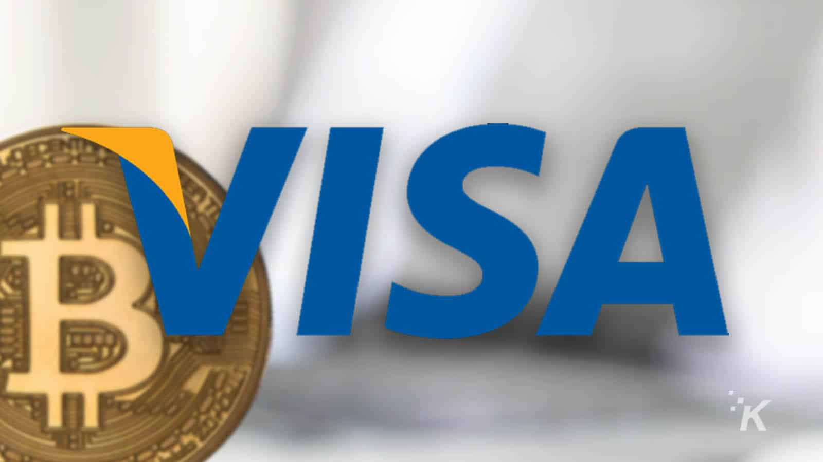 visa logo with bitcoin blurred in the background