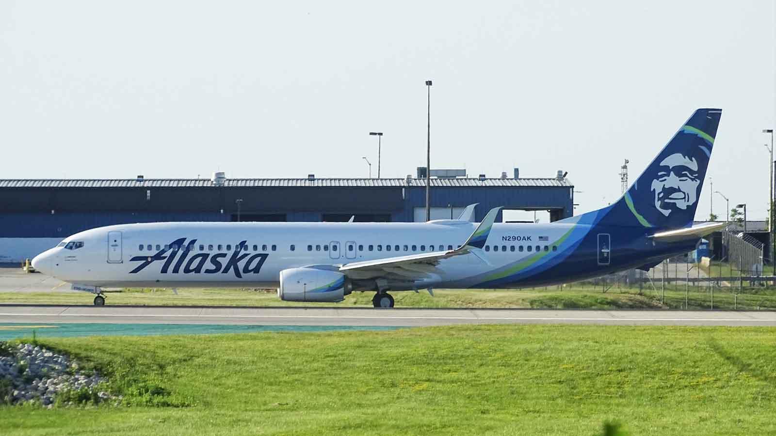 alaska airlines plane on landing strip