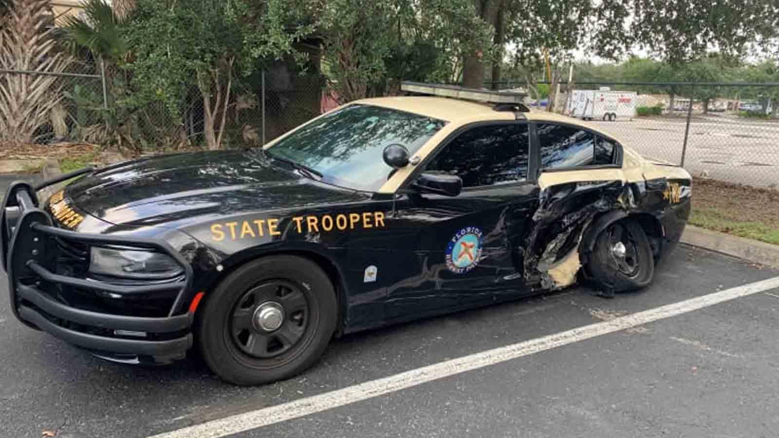 tesla autopilot crash into cop car in florida