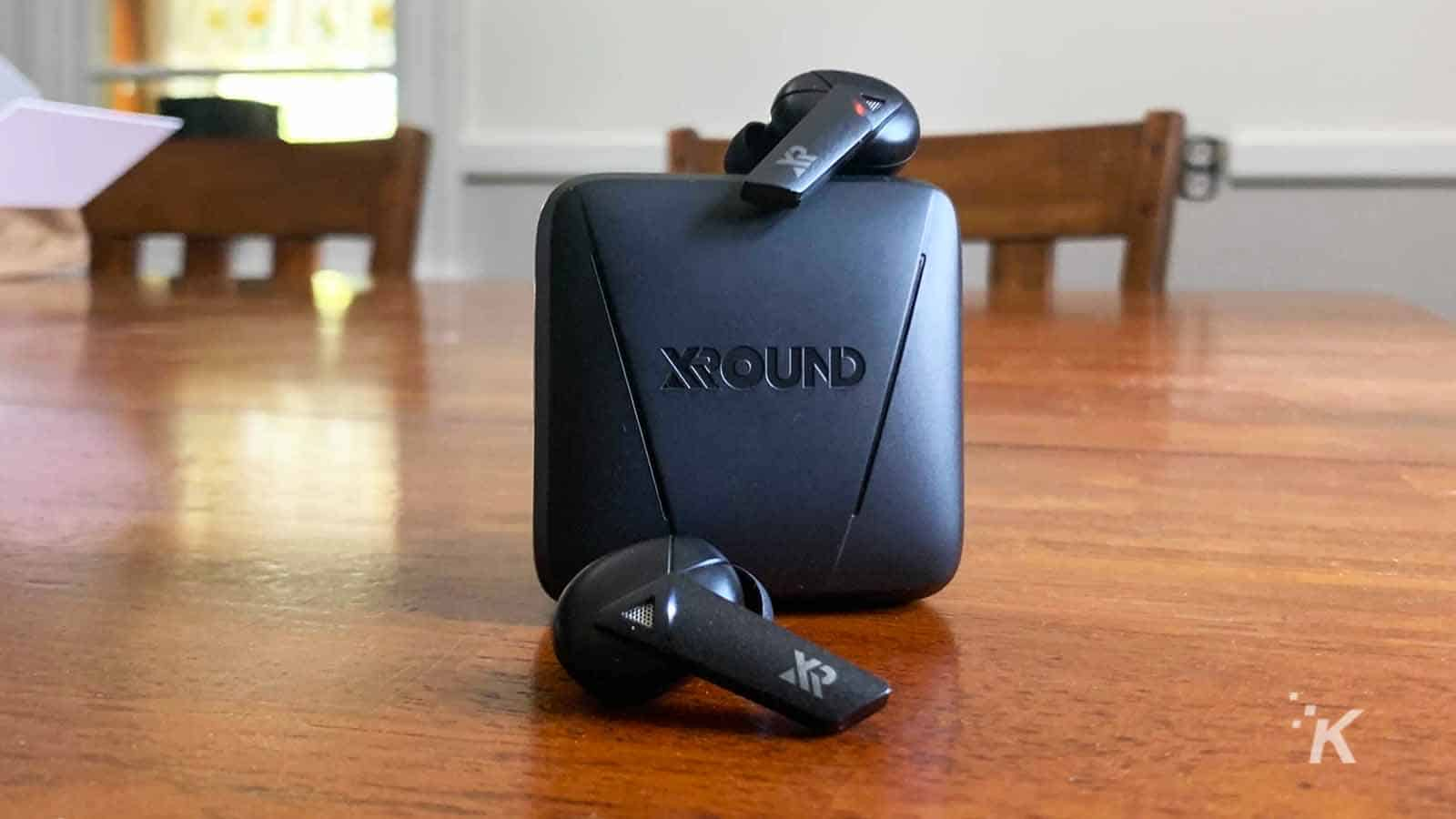 xround aero earbuds on table