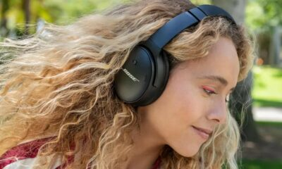 bose quietcomfort 45 headphones worn by a woman with blonde hair