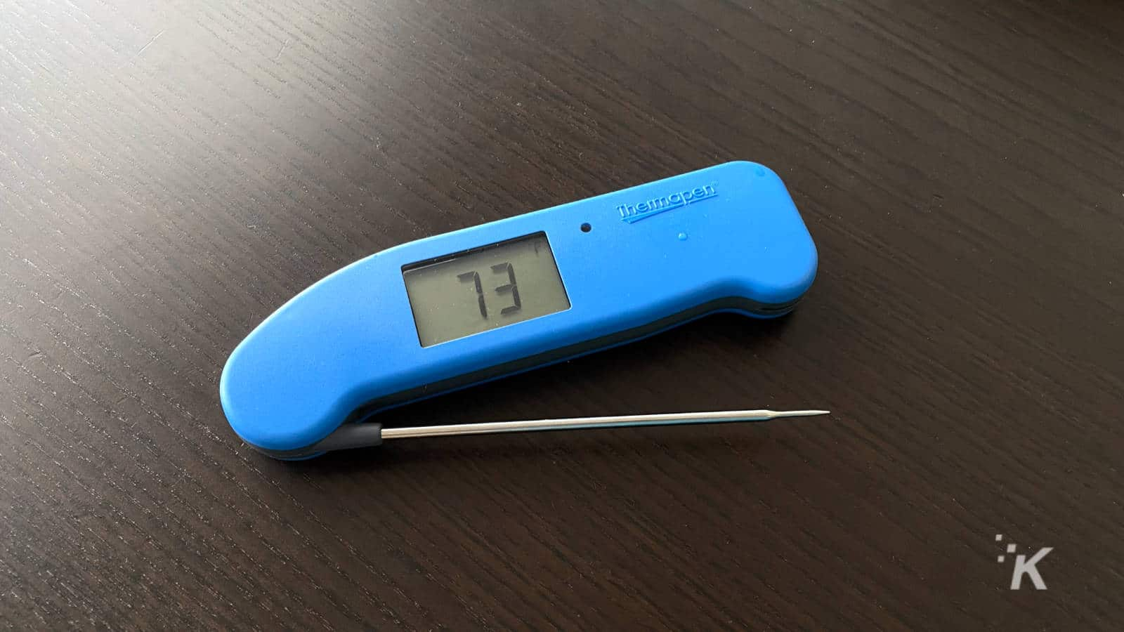 thermapen one on table, open to show it taking the air temperature at 72f