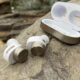 bowers and wilkins pi7 earbuds on a rock